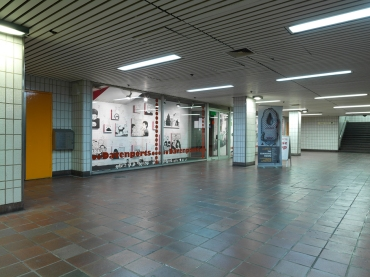 Mixed-media installation (india ink and acrylic drawings on wall and canvas, white stoneware figurines) The Changing Room Exhibition, curated by Aida Eltorie. Charing Cross tube station, London, 2012