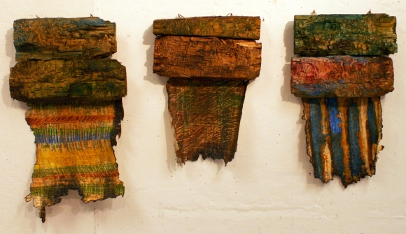Oil on papyrus and carved wood, 2008. Dimensions from left to right: 43 cm x 24 cm, 33 cm x 23 cm, 36 cm x 23 cm.